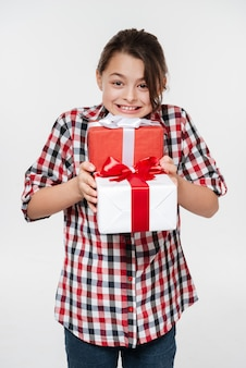 Happy young girl posing with two gifts