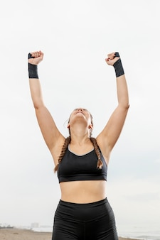 Happy young girl in sportswear celebrating