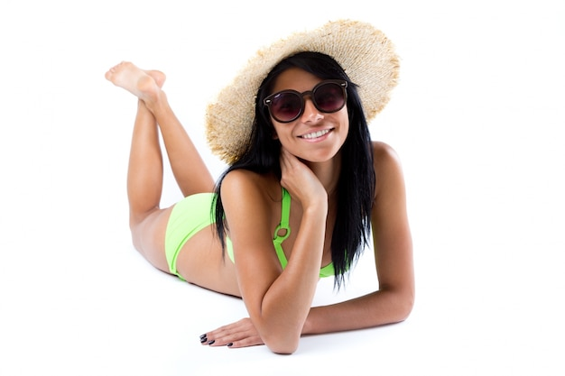 Happy young girl with hat and green bikini
