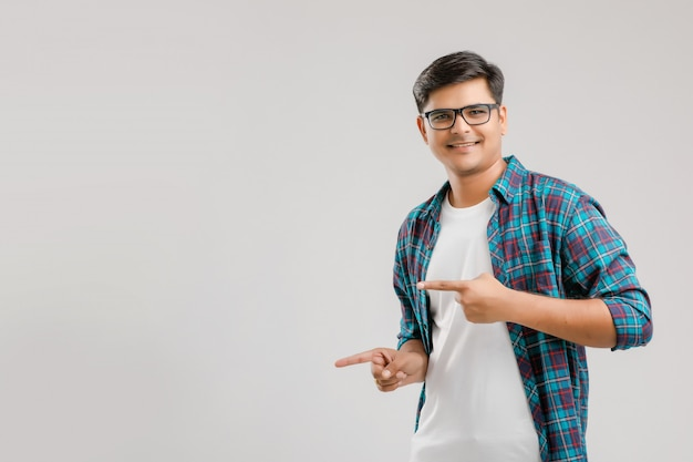 Happy young indian man over white background
