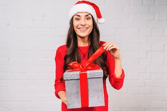 Happy young lady with present box