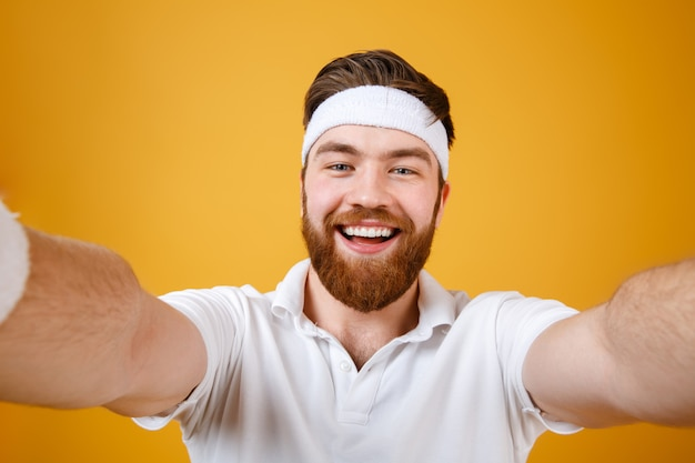 Happy young man make selfie. looking at camera.