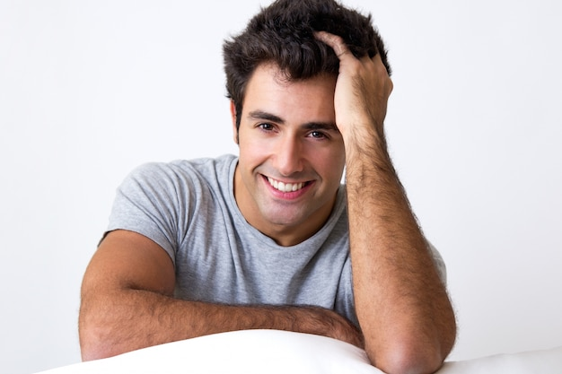 Happy young man relaxing at home