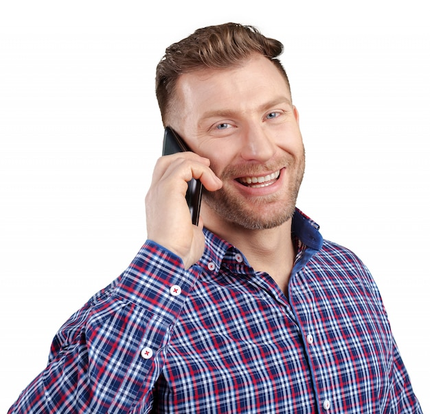 Happy young man talking on cell phone