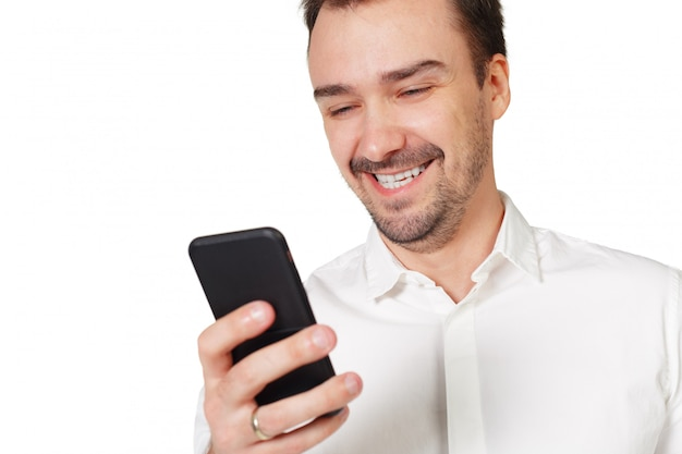 Happy young man using mobile phone