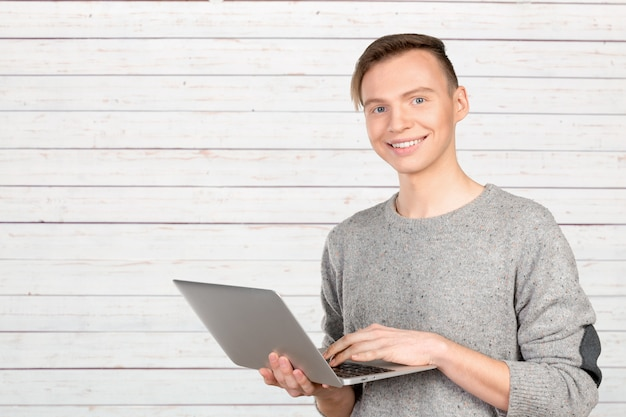 Happy young man with laptop