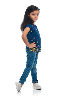 Happy young model girl posing for fashion isolated