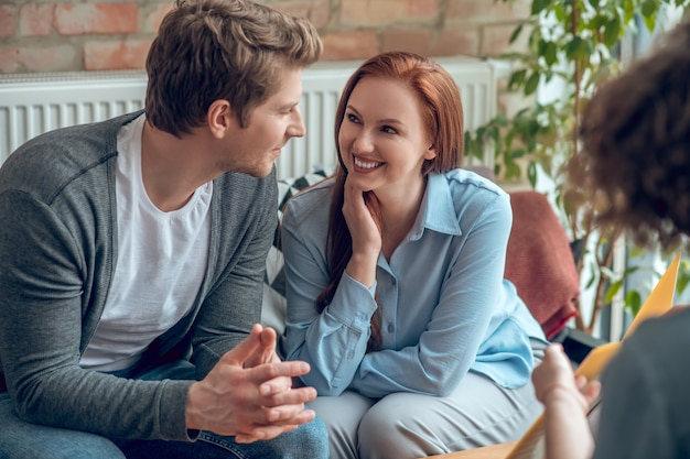 Happy young people buying real estate