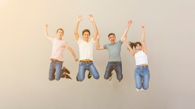 Happy young people jumping together