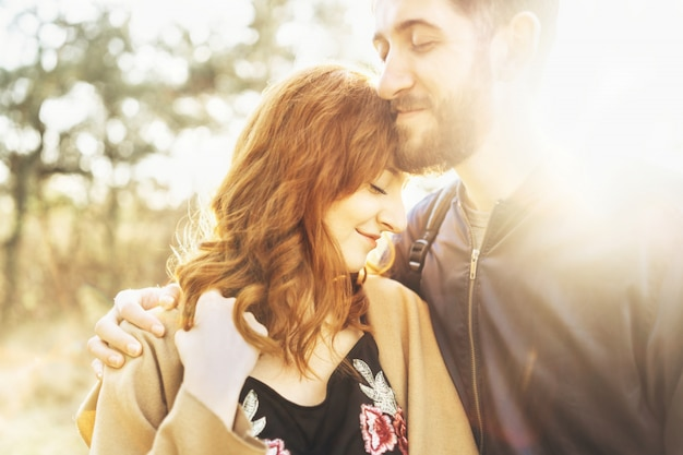 Happy young romantic couple spend time together outdoor.