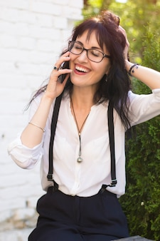 Happy young spanish woman talking on the phone.