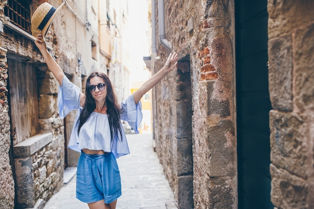 Happy young urban woman in european city.