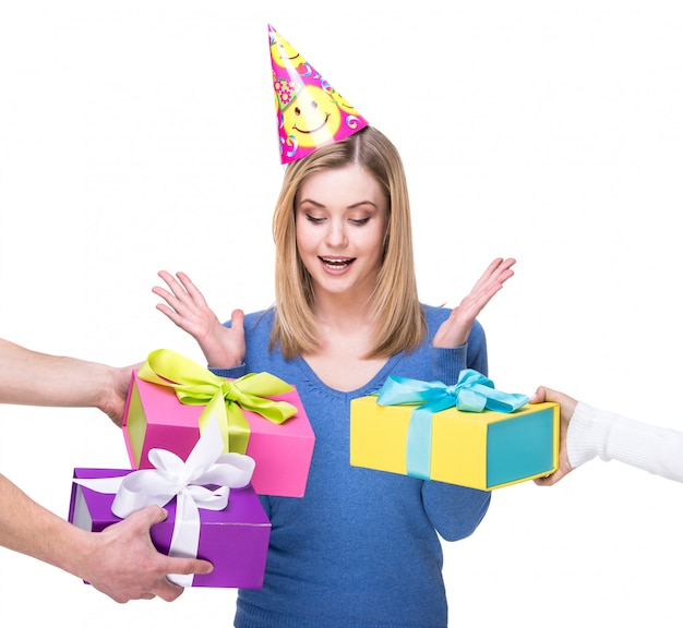 Happy young woman accepts gifts on her birthday.