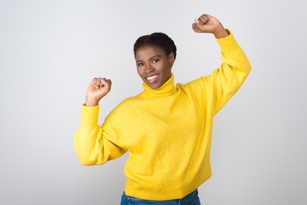 Happy young woman celebrating success