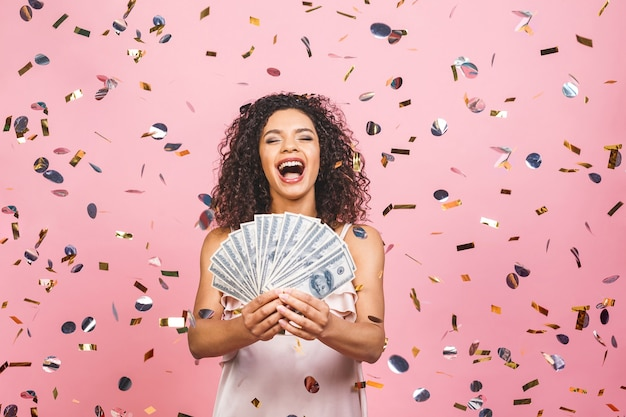 Happy young woman holding dollar currency