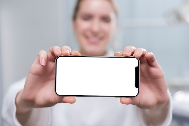 Happy young woman holding mobile phone
