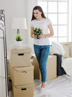 Happy young woman standing in her new apartment