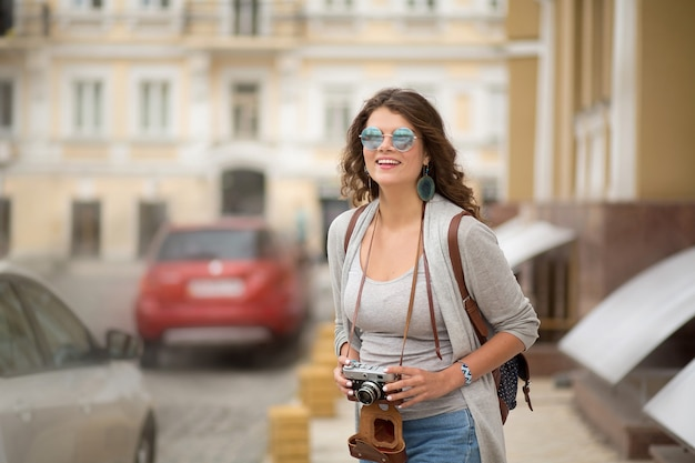 Happy young woman traveling in europe.