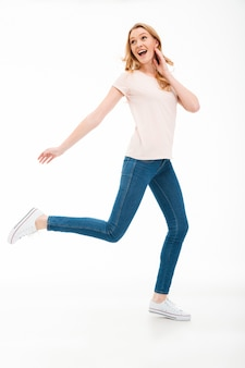 Happy young woman walking