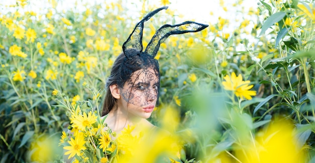 Happy young woman wearing bunny ears and having easter eggs. bunny rabbit ears costume.