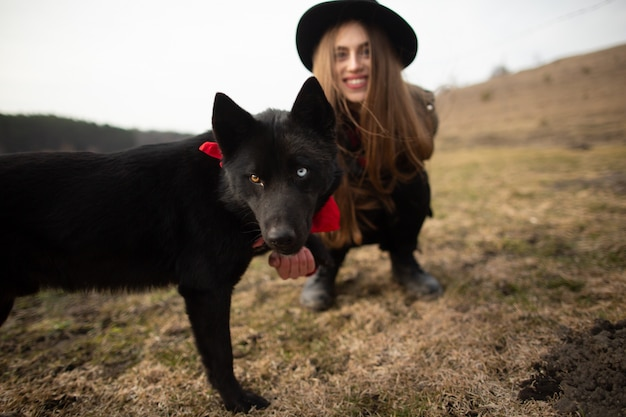 Happy young woman with black hat