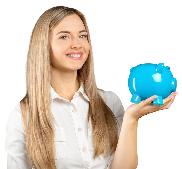Happy young woman with a money box isolated on white
