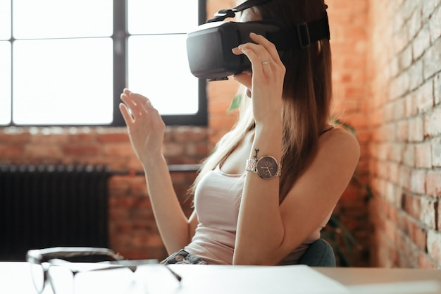 Happy young woman with vr headset. playing at home