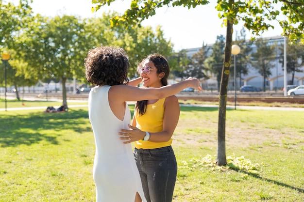 Happy young women hugging in park