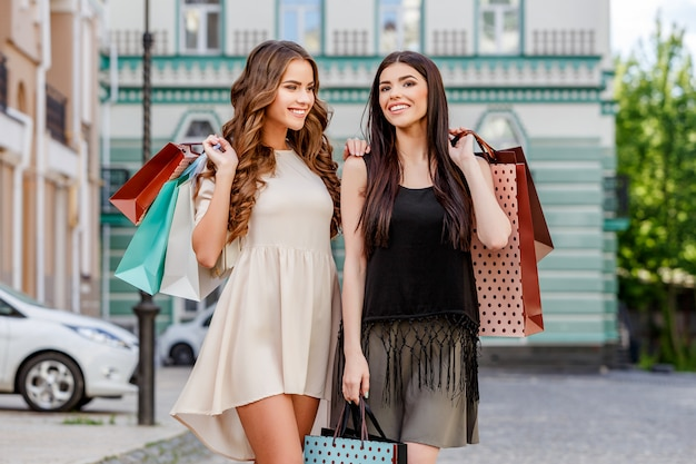 Happy young women with shopping bags