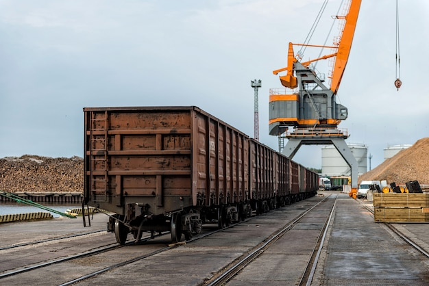 Harbor cranes and railway freight wagons.