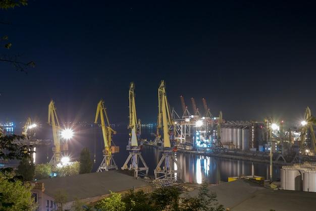 Harbor cranes at work at night