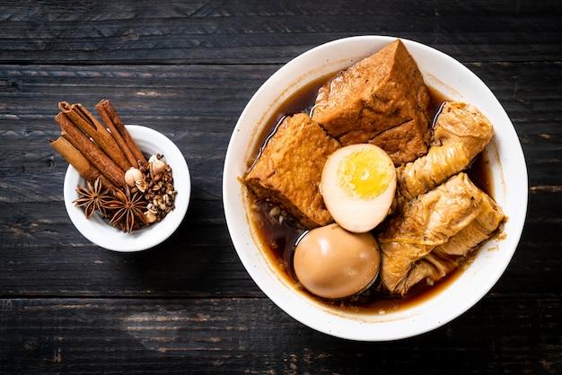 Hard-boiled egg in brown sauce or sweet gravy