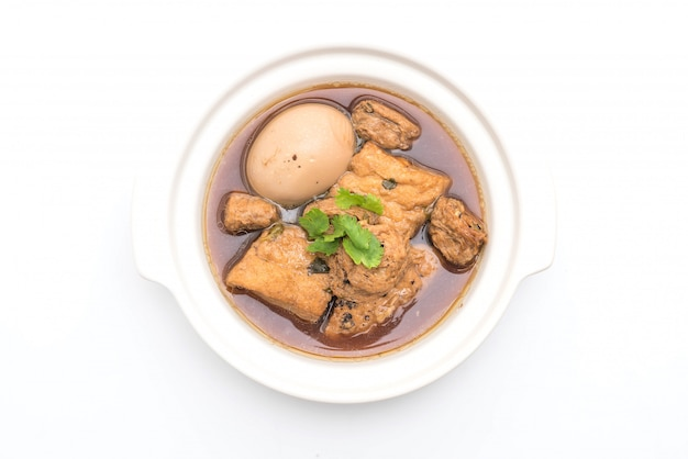 Hard-boiled eggs in the sweet gravy with tofu