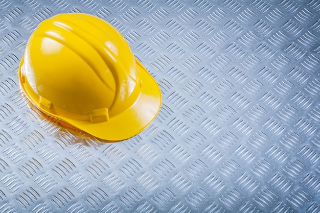 Hard hat on corrugated metal sheet construction concept
