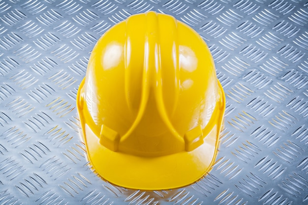Hard hat on fluted metal background construction concept