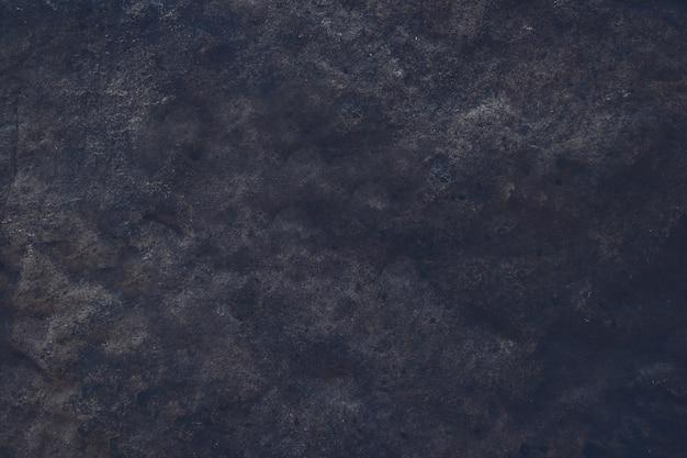 硬くて重い暗い灰花崗岩の石の表面