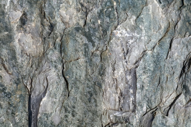 インテリアの壁紙と背景のための洞窟の硬い重い花崗岩の石の表面