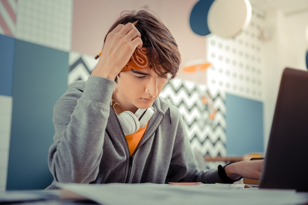 Hard study. the student having difficulties with his homework project
