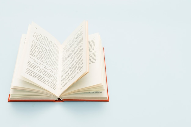 Hardcover open book with copy space