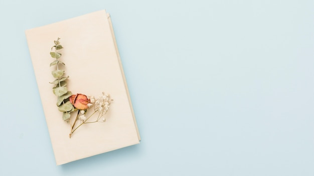 Hardcover open book with flowers