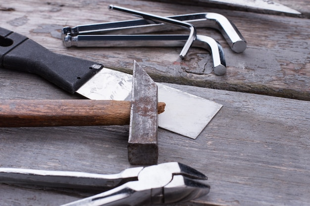 Hardware tools and instruments on wooden background