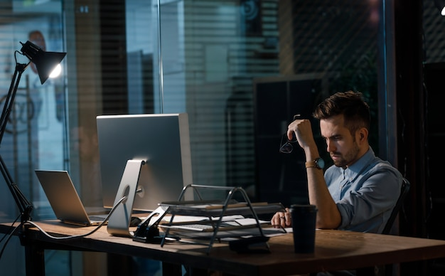 Hardworking man alone in evening office