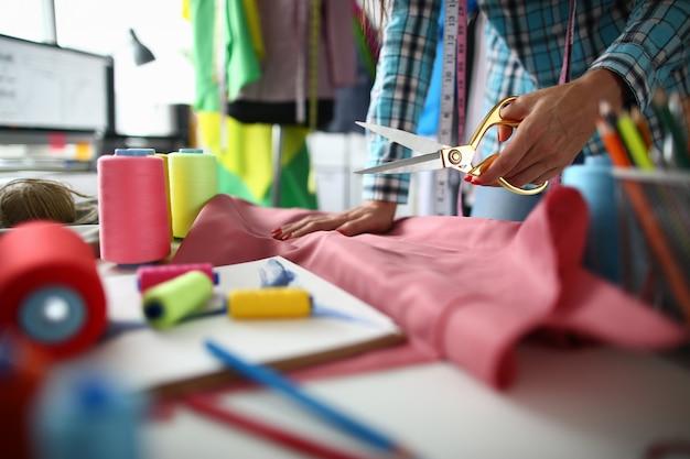 Hardworking tailor with scissors
