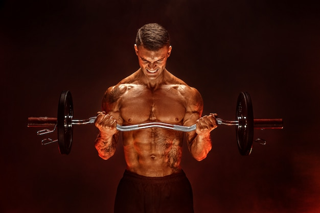 Hardy man doing exercise with heavy bar