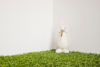 Hare with bow figurine on grass