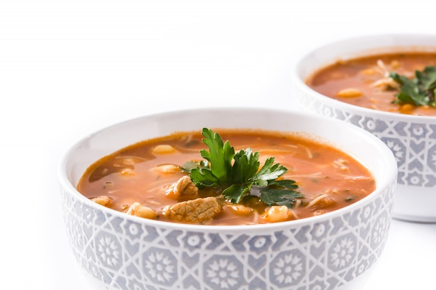 Harira soup in bowl isolated on white typical moroccan food.