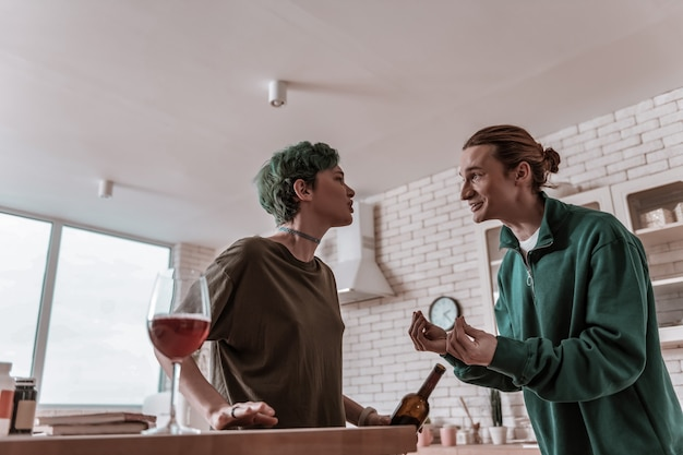Harm of alcohol. caring loving handsome husband explaining his wife the harm of alcohol