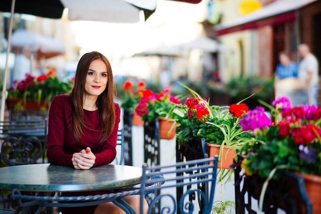 Harming woman with beautiful smile reading good news on mobile phone during rest in coffee shop