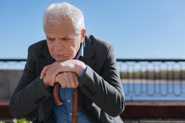Harsh thoughtful san man feeling nostalgic and analyzing his life while having a rest