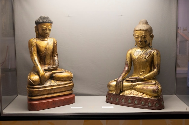 Hartlepool, u.k - july 27, 2021: the national museum of the royal navy, in the north of england. wooden golden budha statue.